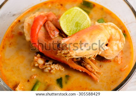 Tom Yum Goong - Famous and very delicious food that hot and spicy soup with shrimp that could easily found in most of resturant in Thailand, serve in glass bowl. Thai Cuisine
