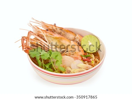 Tom Yum Goong / noodles hot and sour soup isolated on white background with clipping path. - stock photo