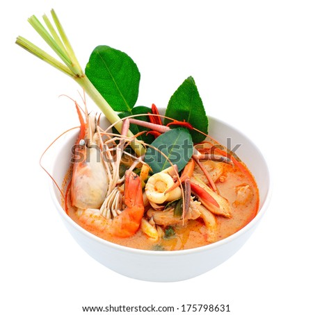 Tom Yum Goong or spicy tom yum soup with shrimp. Thai popular food menu, contained in bowl. - stock photo