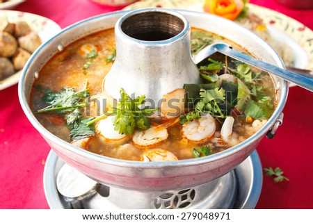 Tom Yum Goong, spicy soup with shrimp in a hot pot, thai cuisine.