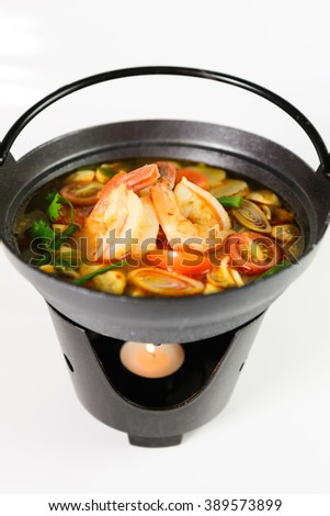Tom Yum Goong. Spicy soup with shrimp in a hot pot, Thai cuisine