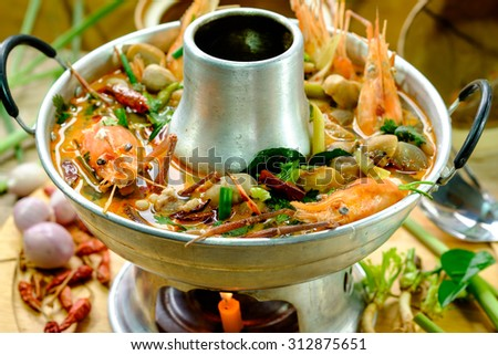 Tom Yum Goong.spicy soup with shrimp in a hot pot,thai cuising - stock photo