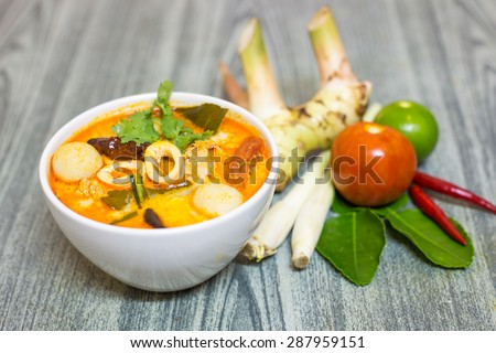 Tom Yum Kung-Thai spicy soup with Herb set of Tom Yum Soup Ingredients on wood background - stock photo
