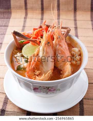 Tom Yum seafood soup or spicy tom yum seafood soup ,Thai food - stock photo