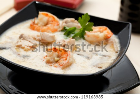 Tom Yum soup with shrimp in coconut milk - stock photo