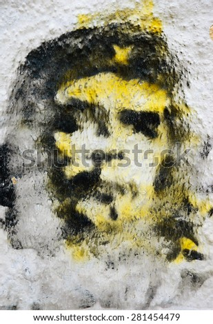 TOMAR, PORTUGAL - APRIL 28, 2015: Che Guevara graffiti painting on an old building wall. In last decades Che Guevara face became a symbol of revolutionary rebellion in mass pop culture. - stock photo