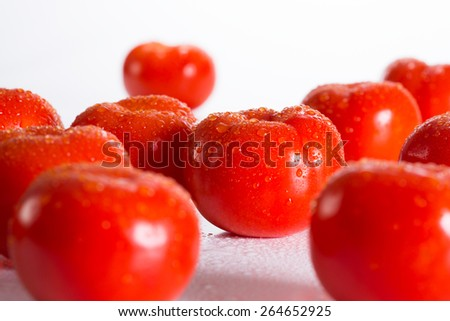 Tomates in drops of water - stock photo