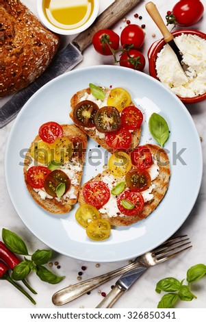 Tomato and basil sandwiches with ingredients - Italian, Vegetarian or Healthy food concept