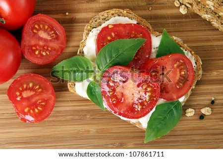 Tomato and basil summer sandwich. - stock photo