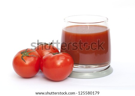 Tomato and juice on the white background