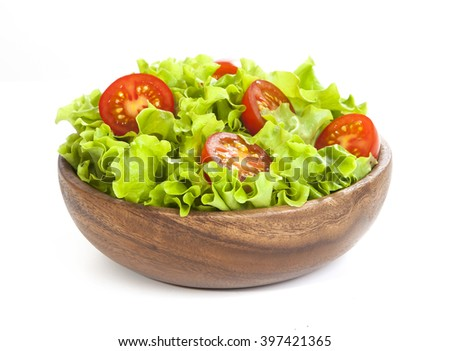 Tomato and lettuce salad in wooden cup isolated on white background - stock photo