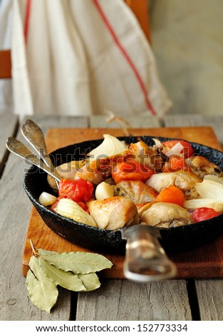 Tomato and mustard chicken in a skillet