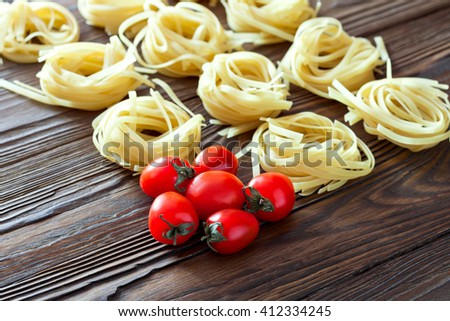 Tomato and pasta ingredients.