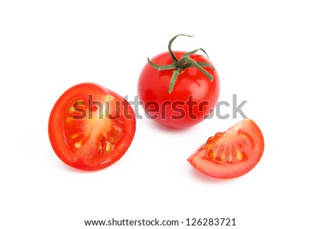 Tomato and slices of tomato on white background