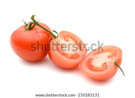 tomato and slices on white background