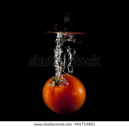 Tomato and water bubbles. Fresh fruits and clean water