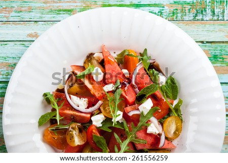 Tomato and Watermelon Salad with Feta and balsamic sauce - stock photo