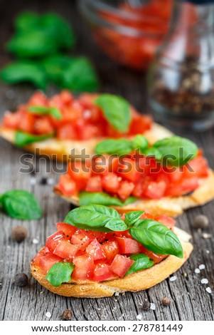 Tomato bruschetta with tomatoes and basil  - stock photo