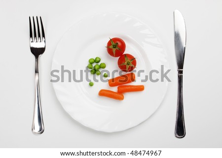 Tomato carrot and green peas served on a plate
