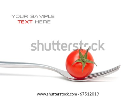 Tomato cherry on a fork. Diet - stock photo