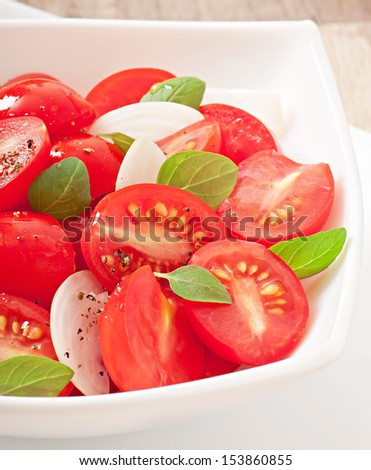 tomato cherry salad with basil, black pepper and onion - stock photo