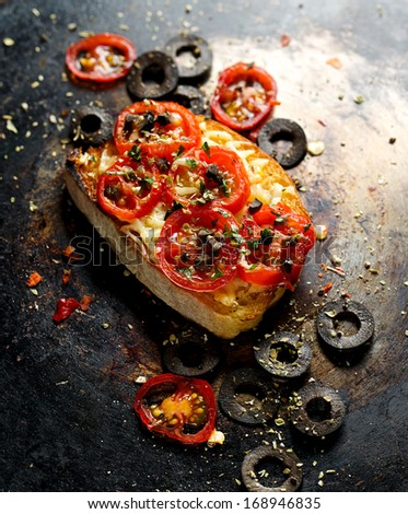 Tomato crostini - stock photo