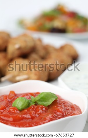 Tomato dip and roast meatballs in background - stock photo