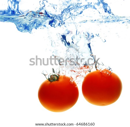 tomato drop in water splash with bubble - stock photo