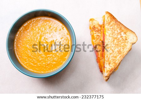 tomato garbanzo soup made with cocnut milk with grilled cheese and tomato sandwich. A healthy meal - stock photo