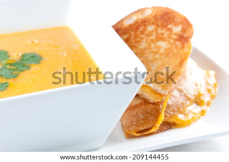 tomato garbanzo soup made with cocnut milk with grilled cheese sandwich. A healthy meal - stock photo