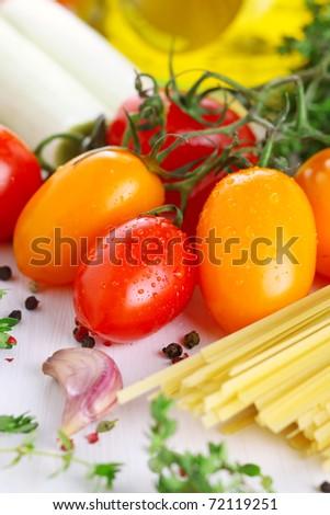 Tomato, garlic, pepper, olive oil and pasta - stock photo