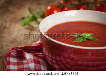 Tomato gazpacho soup on wooden table