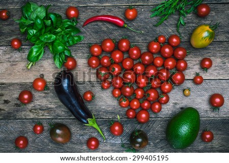 Tomato heart shape and vegetables as healthy lifestyle concept on wooden table it rustic style - stock photo