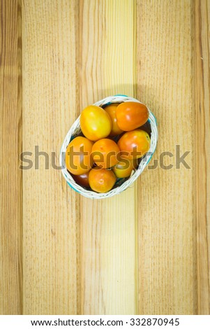 Tomato in basket paste on wooden backgroud - stock photo