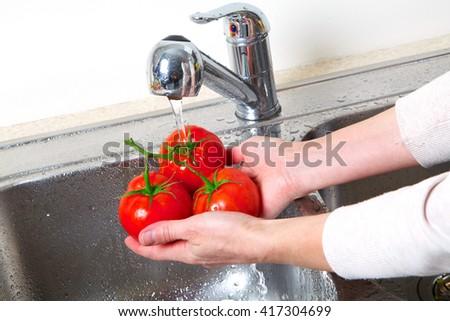 Tomato in the sink. Fresh red tomato - stock photo