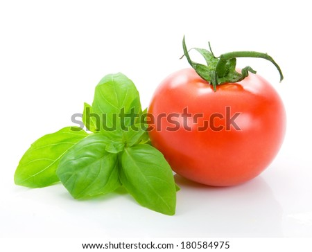 Tomato isolated and basil - stock photo