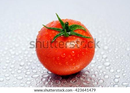 Tomato isolated on white background - stock photo