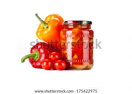 Tomato jam with pepper in glass jar. Isolated on white - stock photo
