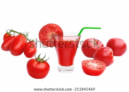 Tomato Juice in glass and ripe tomatoes isolated on white background - stock photo