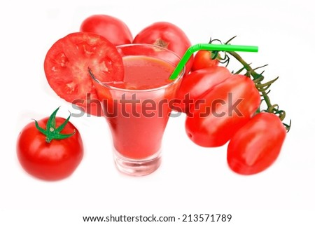 Tomato Juice in glass and ripe tomatoes isolated on white background