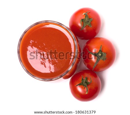 Tomato juice in the glass, cherry tomatoes isolated on white - stock photo