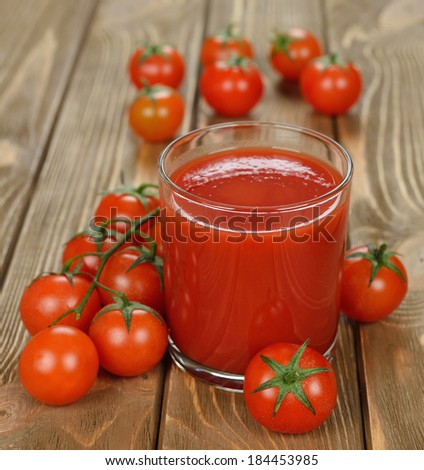tomato juice on brown background - stock photo