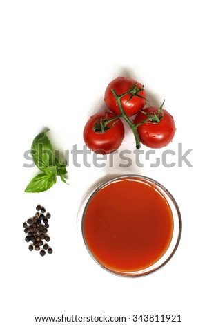 Tomato juice with ingredients from above - stock photo