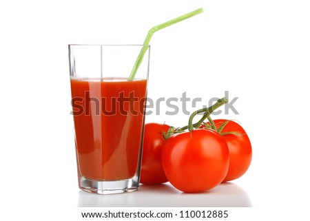 Tomato juices in glass with a straw and tomatoes