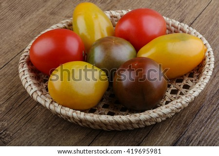 Tomato mix in the bowl on wood background