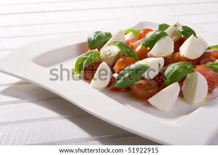 Tomato, mozzarella and fresh basil - stock photo