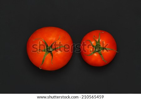 Tomato on a black background - stock photo