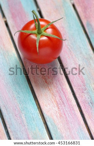 Tomato on rustic wooden background
