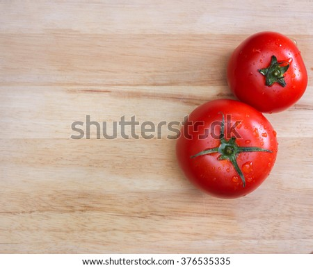 Tomato on the cutting board background