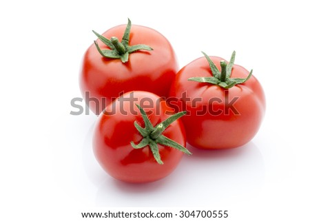 Tomato on the white isolatd background. - stock photo